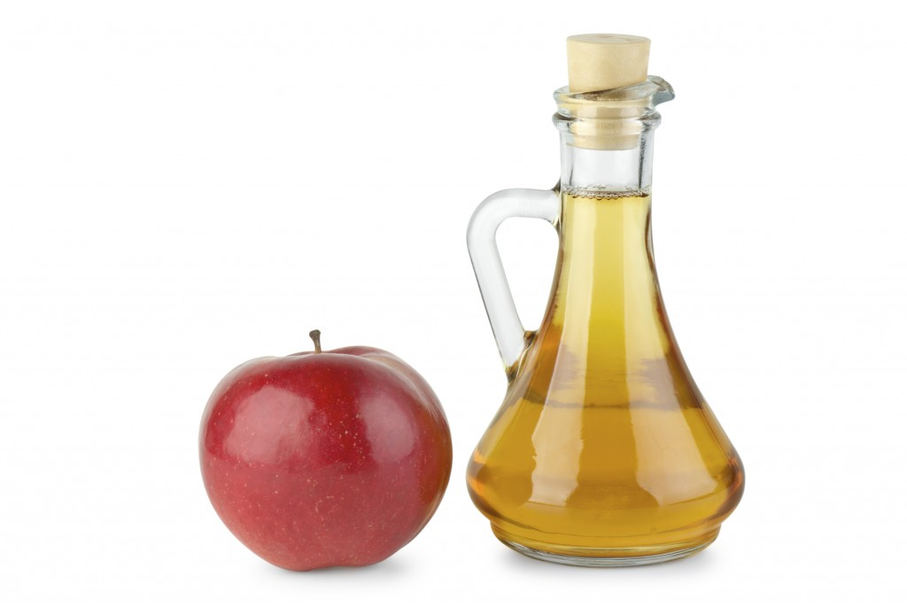 Decanter with vinegar and red apple